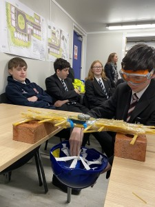 Pupils from The Minster School testing spaghetti bridge
